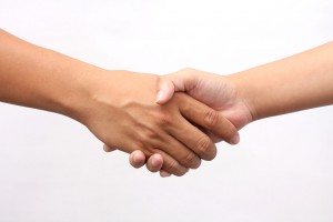 42908267 - successful man and woman handshaking on white background