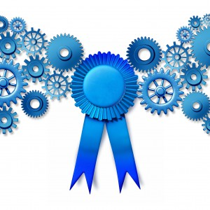 47254935 - business award concept as a blue ribbon reward turning connected gears and cog wheels as an industry honor for working leadership and the best efficiency technology.